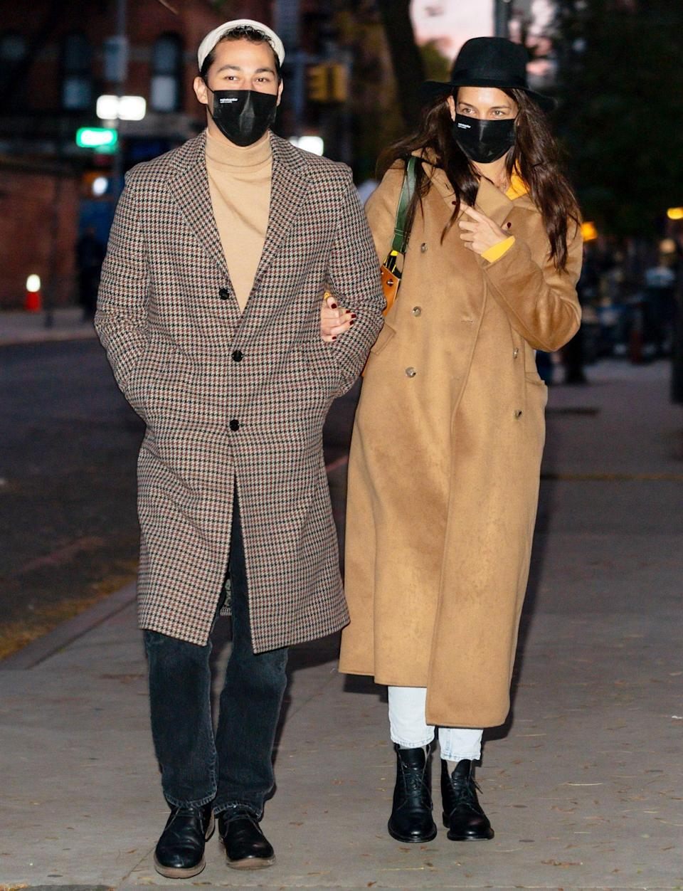 <p>Katie Holmes and boyfriend Emilio Vitolo Jr. step out in chic coats on Tuesday in N.Y.C. </p>