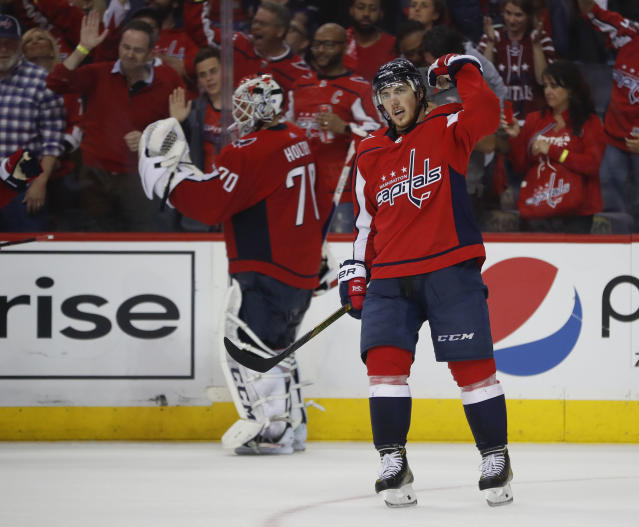 Washington Capitals right wing T.J. Oshie (77) and Capitals goaltender Braden Holtby (70) celebrate after Oshie's goal against the Tampa Bay Lightning during the third period of Game 6 of the NHL Eastern Conference finals hockey playoff series, Monday, May 21, 2018, in Washington. Capitals won 3-0. (AP Photo/Pablo Martinez Monsivais)