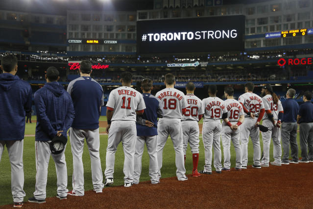 The Boston Red Sox stand during a moments silence before a game against the Toronto Blue Jays at Rogers Center in Toronto, Ontario, Canada, April 24, 2018. (Photo: John E. Sokolowski-USA TODAY Sports/Reuters)