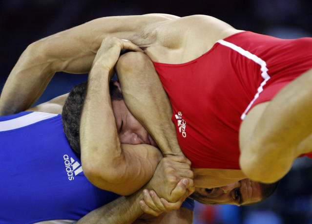 Murad Gaidarov, bottom, of Belarus, wrestles against Gheorghita Stefan of Romania, for the bronze medal of 74Kg category of men's freestyle wrestling competition of the Beijing 2008 Olympics in Beijing, Wednesday, Aug. 20, 2008. Gaidarov won the bronze. (AP Photo/Saurabh Das )