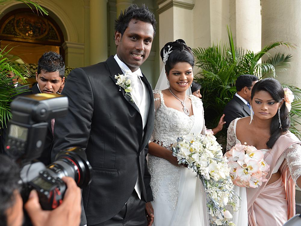 Sri Lanka cricket skipper Angelo Mathews (L) 26, and his bride Heshani look on during their wedding at a Roman Catholic church in Colombo on July 18, 2013.  AFP PHOTO/ Ishara S.KODIKARA