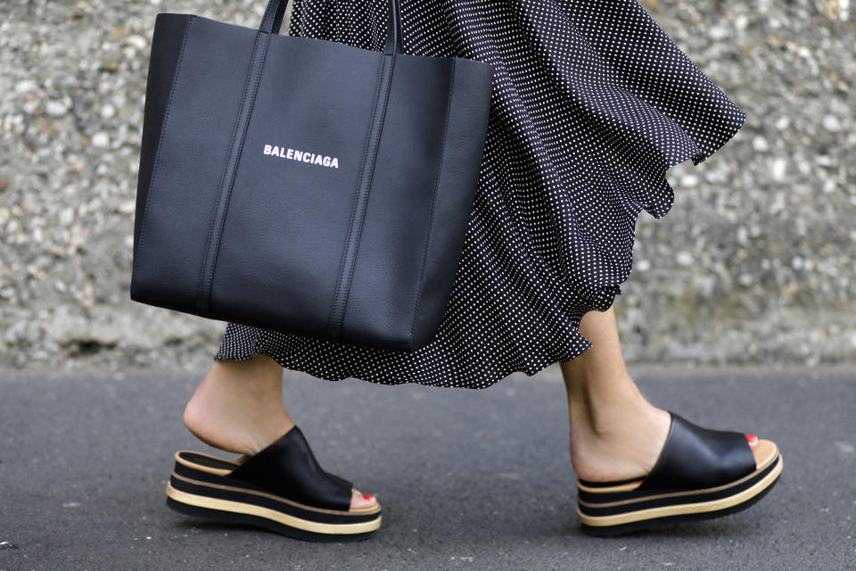 WUERZBURG, GERMANY - MAY 21: Fashion designer Eva Lutz, wearing a black dress with white polka dots by Alice + Olivia, a black shopper bag by Balenciaga and black platform sandals by Paloma Barcelo during a street style shooting on May 21, 2020 in Wuerzburg, Germany. (Photo by Streetstyleograph/Getty Images)
