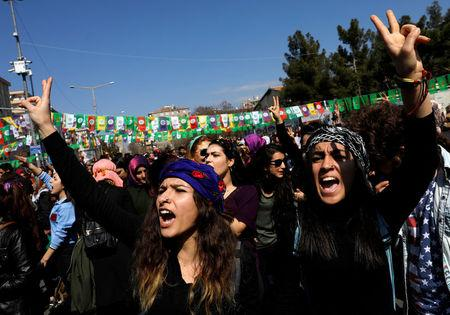 Women shout slogans during a rally in southeastern province of Diyarbakir, Turkey, March 8, 2017. Picture taken March 8, 2017. REUTERS/Umit Bektas