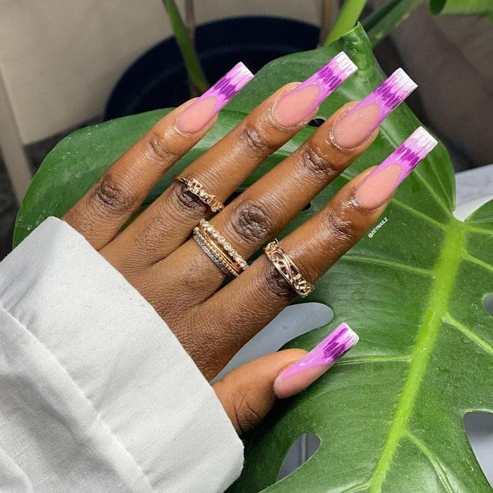 There are just so many ways to remix French manicures that it's impossible to include them all. Zey added these squiggly lines in shades of purple, lavender, and white. The length and square shape are the perfect canvas for this French mani.