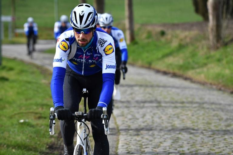 Belgian Tom Boonen of Quick-Step Floors rides his bike during a track reconnaissance at the cobblestones area in Zottegem, Belgium on February 24, 2017