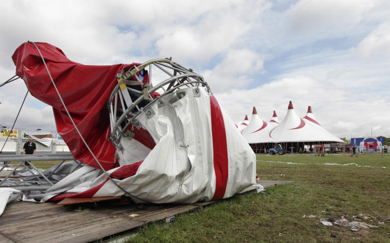 A damaged tent at the festival campsite near Hasselt, 50 miles (80 kilometers) east of Brussels, Friday Aug.19, 2011. Five people died in a fierce thunderstorm on Thursday, that mangled tents and downed trees and scaffolding at the open-air music festival PukkelPop in Belgium. Organizers canceled the annual four-day festival. (AP Photo/Yves Logghe)