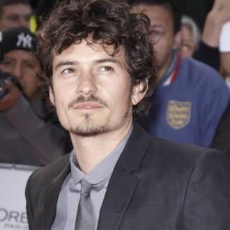 Orlando Bloom keeping movie costumes for sons