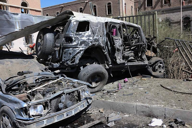 This photo provided by Yemen's Defense Ministry shows damaged vehicles after an explosion at the Defense Ministry complex in Sanaa, Yemen, Thursday, Dec. 5, 2013. A suicide bomber detonated his explosives-laden car Thursday at Yemen's Defense Ministry, killing more than a dozen soldiers and wounding at least 40 in an attack underlining the persistent threat to the stability and security of the impoverished Arab nation, military and hospital officials said. (AP Photo/Yemen's Defense Ministry)