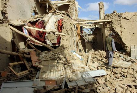 FILE PHOTO - An Afghan man inspects a house destroyed during an air strike called in to protect Afghan and U.S. forces during a raid on suspected Taliban militants, in Kunduz