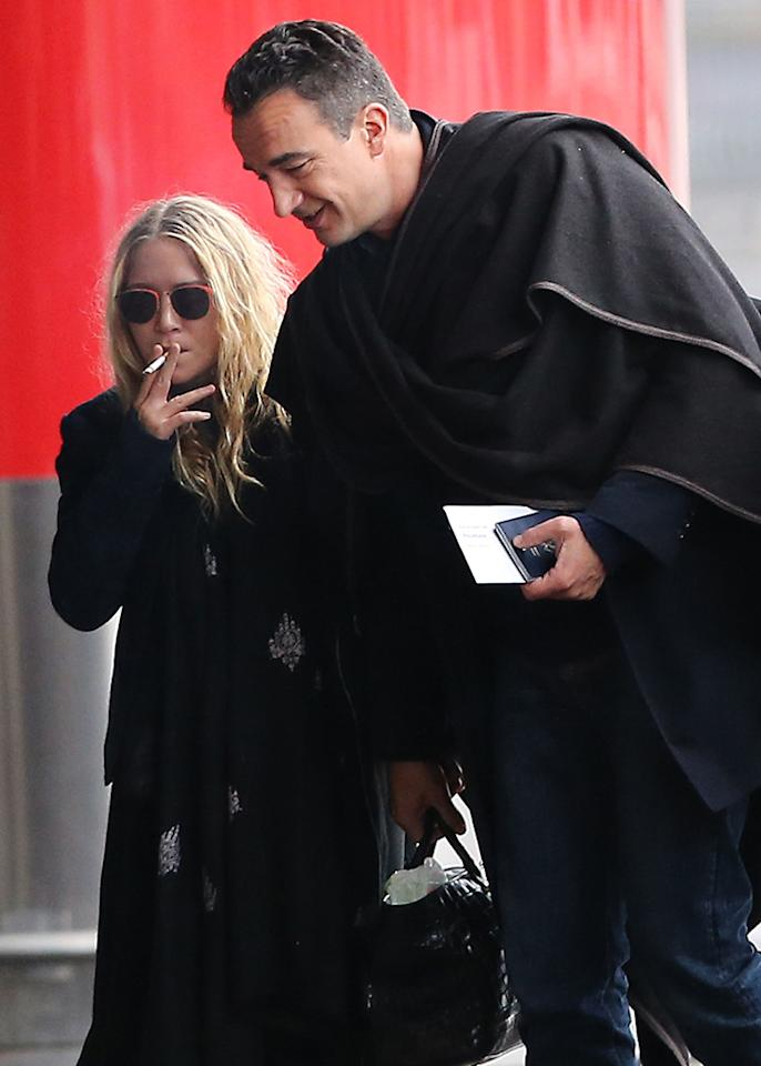 Exclusive... 50984048 Actress and fashionista Mary-Kate Olsen departing on a flight at Roissy airport in Paris, France with her much older French boyfriend Olivier Sarkozy on January 6th, 2013. The happy couple aren't afraid to show some PDA while they wait for their flight. No Internet Use Without Prior Agreement  FameFlynet, Inc - Beverly Hills, CA, USA -  1 (818) 307-4813 RESTRICTIONS APPLY: USA/AUSTRALIA ONLY