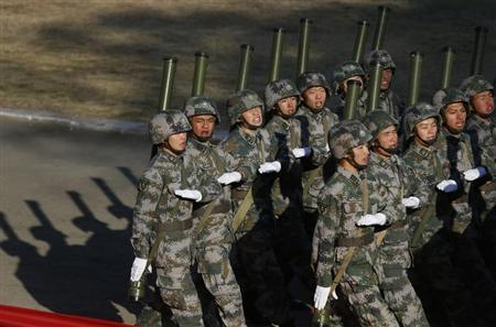 Soldiers of the Chinese People's Liberation Army march during their drill ahead of their year-end review in Jiaxing