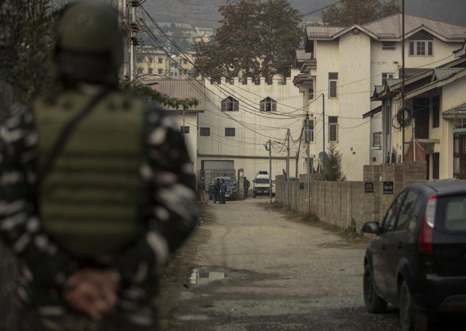 An Indian paramilitary soldier stands guard as National Investigation Agency personnel search the premises of Agence France-Presse's Kashmir correspondent Parvaiz Bukhari on the outskirts of Srinagar, Indian controlled Kashmir, Wednesday, Oct. 28, 2020. (AP Photo/Mukhtar Khan)