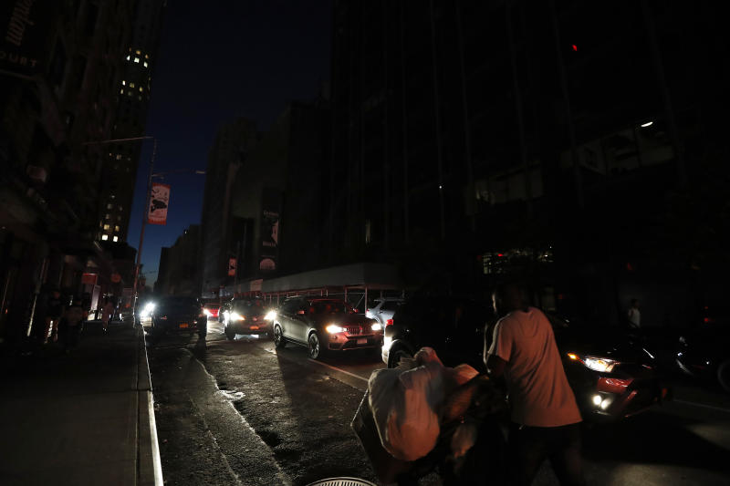 A man makes his way through a dark Times Square during a power outage, Saturday, July 13, 2019, in New York. Authorities were scrambling to restore electricity to Manhattan following a power outage that knocked out Times Square's towering electronic screens and darkened marquees in the theater district and left businesses without electricity, elevators stuck and subway cars stalled. (Photo: Michael Owens/AP)