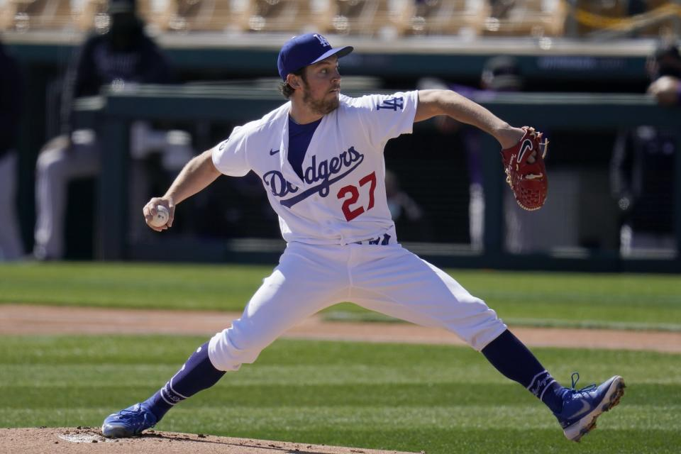 FILE - In this Monday, March 1, 2021, file photo, Los Angeles Dodgers starting pitcher Trevor Bauer throws against the Colorado Rockies during the first inning of a spring training baseball game in Phoenix. (AP Photo/Ross D. Franklin, File)