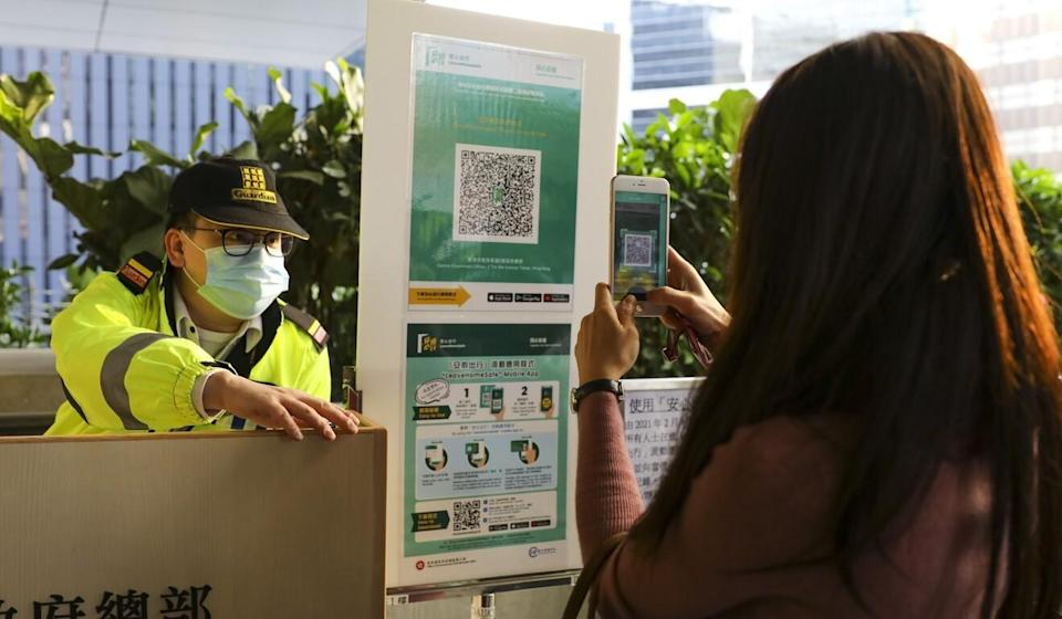 Civil servants began offering proof they had used the government's coronavirus-focused 'Leave Home Safe' app on Thursday. Sam Tsang