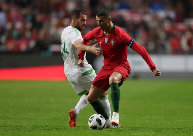 Soccer Football - International Friendly - Portugal vs Algeria - Estadio da Luz, Lisbon, Portugal - June 7, 2018 Portugal's Cristiano Ronaldo in action with Algeria's Salim Boukhanchouche REUTERS/Rafael Marchante