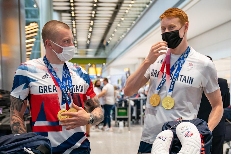 British swimmers Adam Peaty (left) and Tom Dean arrive back at London Heathrow Airport (Aaron Chown/PA) (PA Wire)