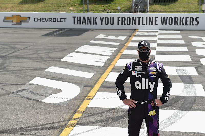 LONG POND, PENNSYLVANIA - JUNE 28: Jimmie Johnson, driver of the #48 Ally Chevrolet, poses on the Start/Finish line to show support for front line workers prior to the NASCAR Cup Series Pocono 350 at Pocono Raceway on June 28, 2020 in Long Pond, Pennsylvania. (Photo by Jared C. Tilton/Getty Images)