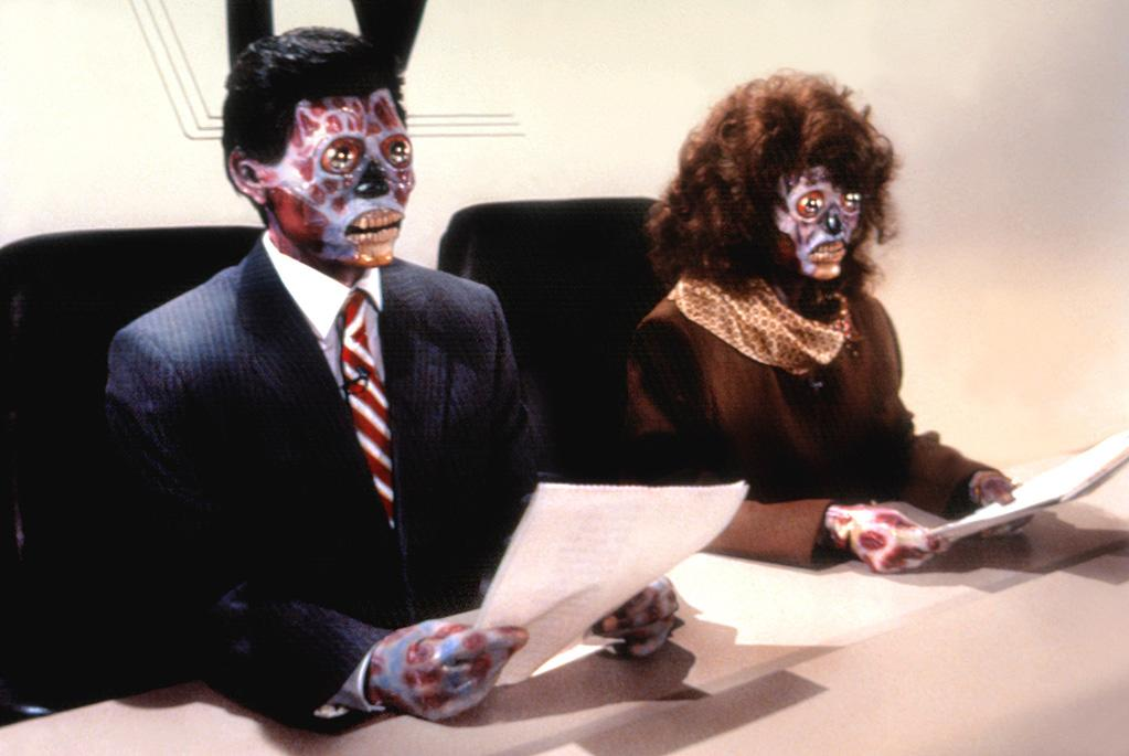 """<b>Aliens You Can Only See With Special Sunglasses</b> <br>""""<a href=""""http://movies.yahoo.com/movie/they-live/"""">They Live</a>"""" (1988)"""