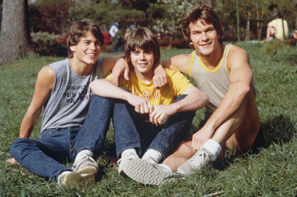<p>Denim was having a moment in the 1980s, as shown in <em>The Outsiders</em>. The stars of the cult-classic film wore head-to-toe denim, like Rob Lowe here in his dark wash skinny jeans. </p>