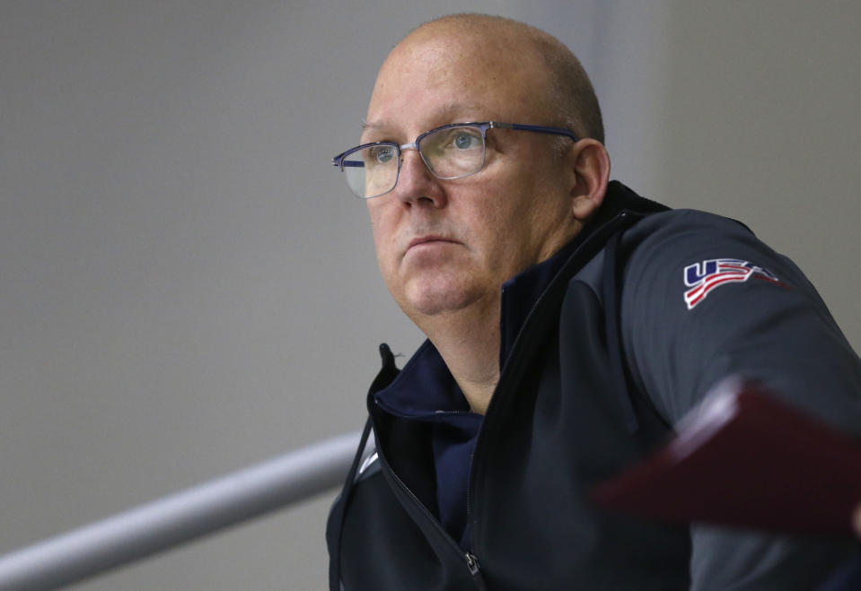 FILE - In this Dec. 17, 2017, file photo, United States' under-20 hockey coach Bob Motzko watches his team scrimmage during hockey practice in Columbus, Ohio. The NCAA men's hockey tournament bracket this year would have made Herb Brooks proud. For the first time, all five Division I programs from Minnesota made the 16-team field. Minnesota is the No. 3 overall seed. (AP Photo/Jay LaPrete, File)