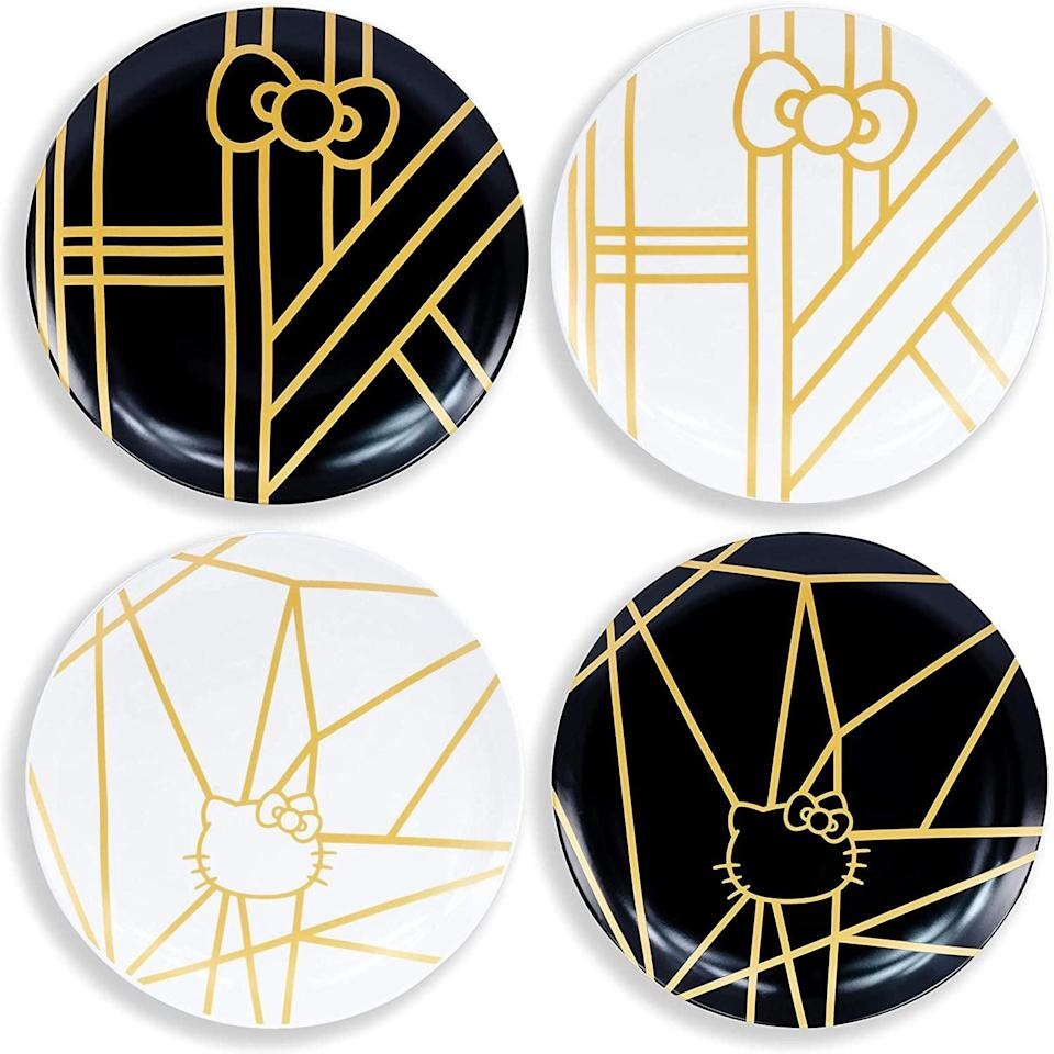 <p>These <span>Underground Toys Hello Kitty Panache Black &amp; Gold 4 Piece Dinner Plate Set</span> ($45) are stunning and abstract.</p>