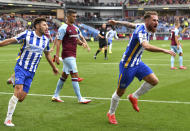 Brighton and Hove Albion's Alexis Mac Allister, right, celebrates scoring their side's second goal of the game during the English Premier League soccer match between Burnley and Brighton and Hove Albion at Turf Moor, Burnley, England, Saturday, Aug. 14, 2021. (Anthony Devlin/PA via AP)