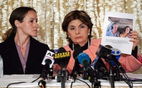 Gloria Allred (R) and her client Teala Davies, who claims to be a victim of sexual abuse by Jeffrey Epstein when she was a minor, hold a press conference in New York  - Credit: AFP