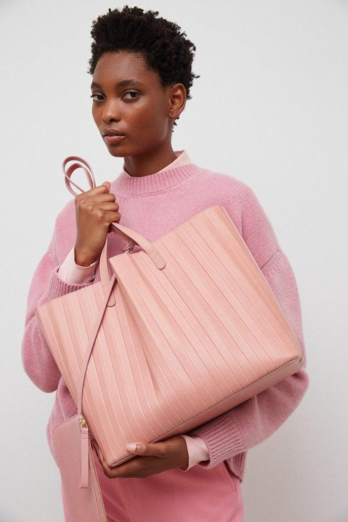 <p>The pink shade of this <span>Mansur Gavriel Pleated Tote</span> ($695) is perfect.</p>