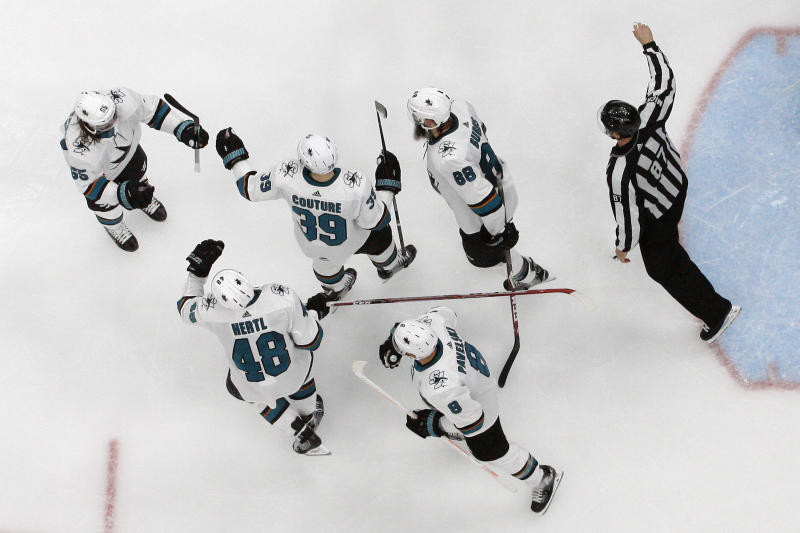 San Jose Sharks center Tomas Hertl (48), of the Czech Republic, celebrates with teammates after scoring a goal against the St. Louis Blues during the third period in Game 4 of the NHL hockey Stanley Cup Western Conference final series Friday, May 17, 2019, in St. Louis. (AP Photo/Jeff Roberson)