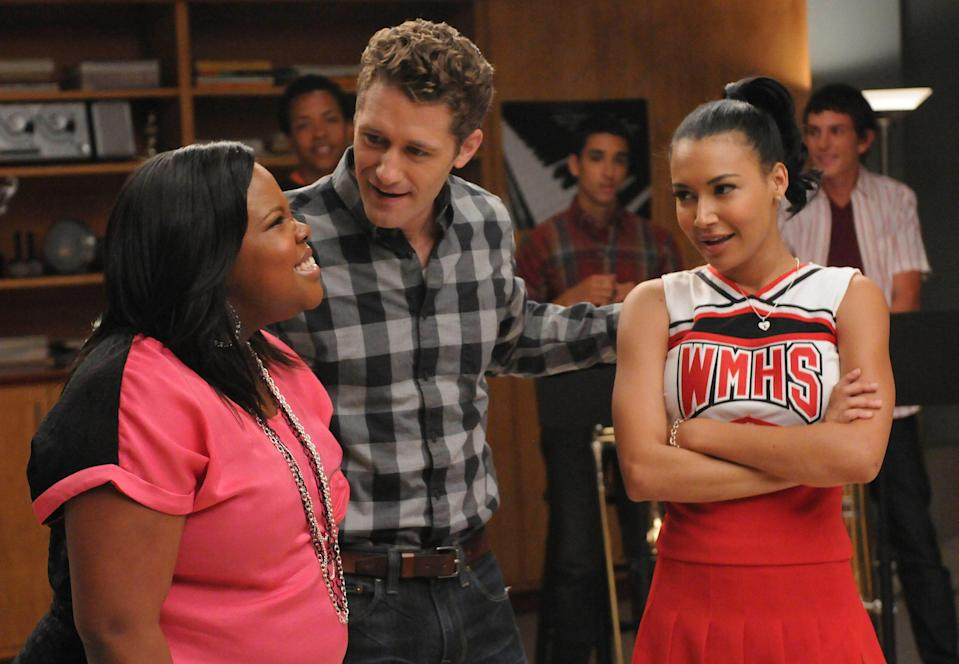 """Will (Matthew Morrison, C) assigns Mercedes (Amber Riley, L) and Santana (Naya Rivera, R) a duet in the """"Duets"""" episode of """"Glee."""""""