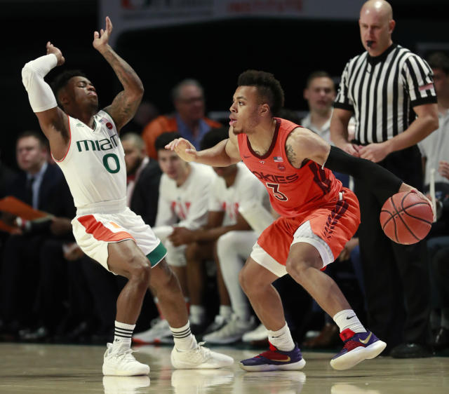 Virginia Tech guard Wabissa Bede (3) bumps Miami guard Chris Lykes (0) as he drives to the basket during the first half of an NCAA college basketball game Wednesday, Jan. 30, 2019, in Coral Gables, Fla. (AP Photo/Wilfredo Lee)