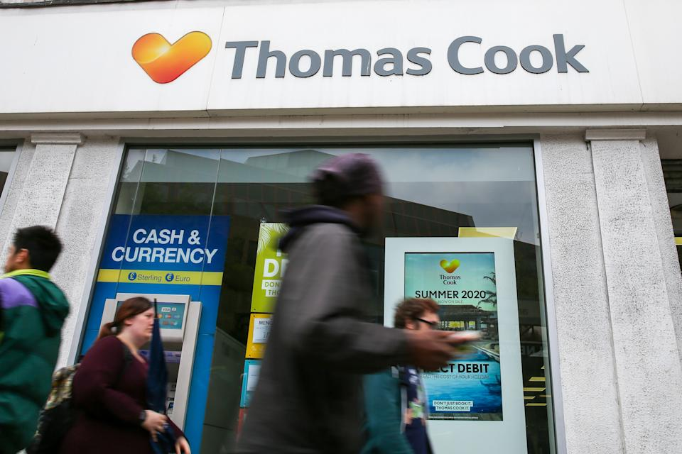 People are seen walking past a Thomas Cook branch in central London. Photo: Dinendra Haria/SOPA Images/LightRocket via Getty Images