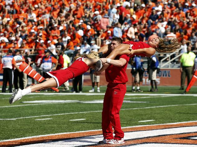 Miami (Ohio) cheerleaders perform after their team scored a touchdown against Illinois during the second half of an NCAA college football game on Saturday, Sept. 28, 2013, at Memorial Stadium in Champaign, Ill. Illinois won the game 50-14.  (AP Photo/Jeff Haynes)