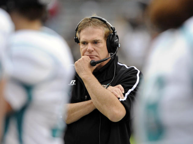 FILE - In this Nov. 23, 2013 file photo, Coastal Carolina head coach Joe Moglia paces the sidelines during the second half of an NCAA college football game against South Carolina in Columbia, S.C. Moglia had made many successful decisions in his time as CEO of TD Ameritrade through cold analysis without the benefit of emotions. He used the same process when deciding to step away from the Chanticleers last summer in the programs first season as an FBS member. Moglia said the choice was the right one and hes healthy and back in charge of Coastal Carolina. He said his choice for a temporary leave means hell be ready for several more seasons. (AP Photo/Stephen Morton, file)