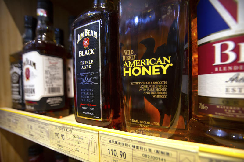 "Whiskeys distilled and bottled in the U.S. are displayed for sale in a grocery store in Beijing, Saturday, July 7, 2018. The trade war that erupted Friday between the U.S. and China carries a major risk of escalation that could weaken investment, depress spending, unsettle financial markets and slow the global economy. An executive at the Distilled Spirits Council said she fears China's tariffs on U.S. whiskey will ""put the brakes on an American success story"" of rising exports of U.S. spirits. (AP Photo/Mark Schiefelbein)"