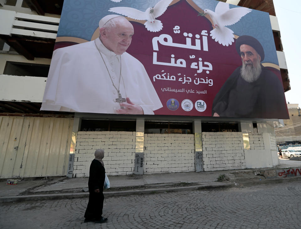 """A billboard showing Pope Francis and Grand Ayatollah Ali al-Sistani, with Arabic that reads, """"You are a part of us and we are a part of you,"""" hangs on a street in Baghdad, Iraq, prior to the upcoming Pope visit, Monday, March 1, 2021. (AP/Photo/Khalid Mohammed)"""