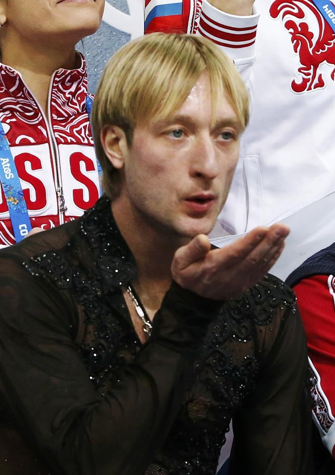 """Evgeny Plyushchenko of Russia's figure skating team celebrates in the """"kiss and cry"""" area during the Team Men Free Skating Program at the Sochi 2014 Winter Olympics, February 9, 2014. REUTERS/Lucy Nicholson (RUSSIA - Tags: SPORT FIGURE SKATING SPORT OLYMPICS)"""