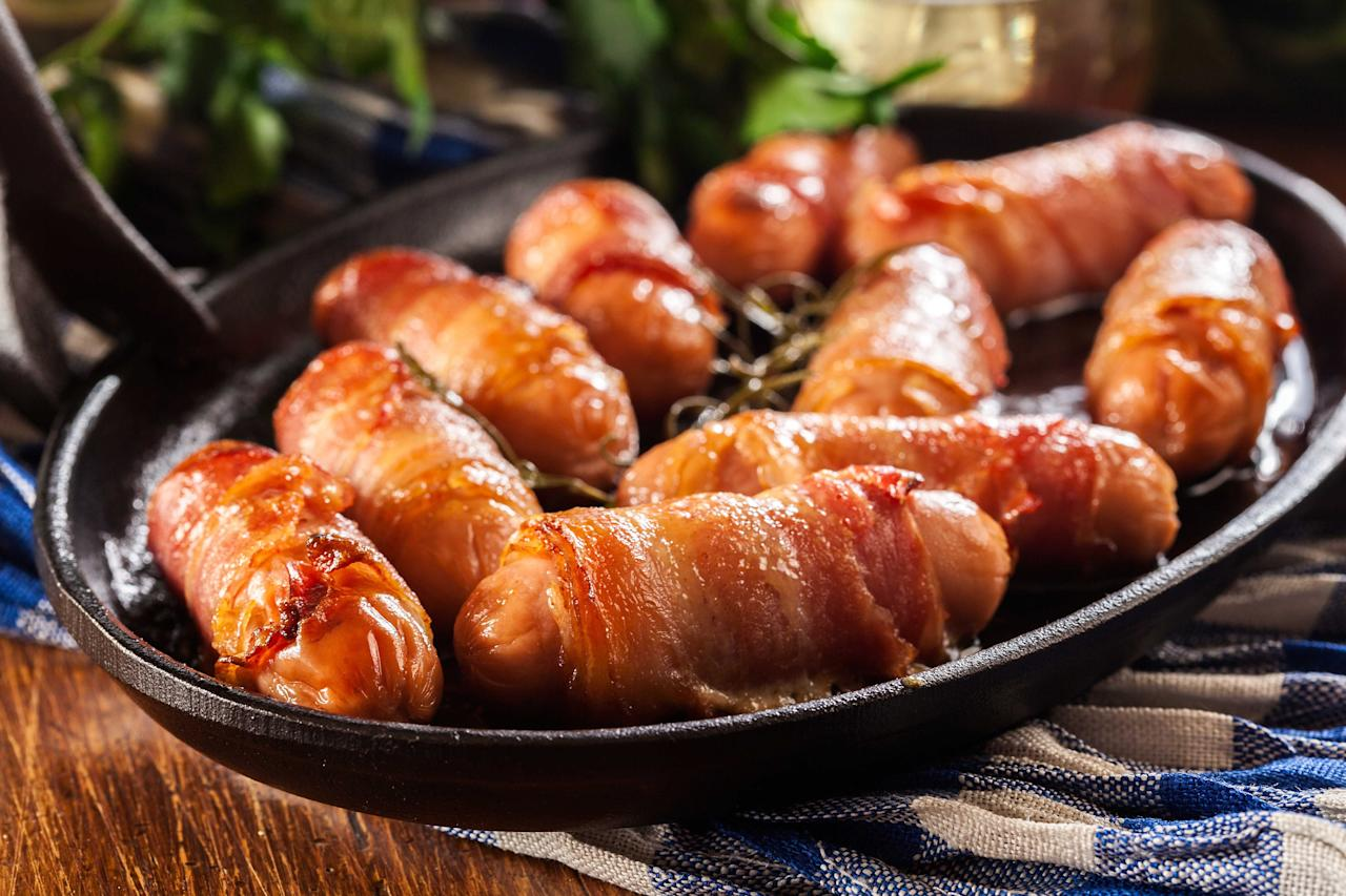 """<p>Pigs in blankets are a <a href=""""https://www.goodhousekeeping.com/uk/christmas/"""">Christmas</a> dinner favourite. The mix of meaty <a href=""""https://www.goodhousekeeping.com/uk/food/food-reviews/g27464832/best-sausages-supermarket/"""" target=""""_blank"""">sausage</a> and <a href=""""https://www.goodhousekeeping.com/uk/food/food-reviews/g677005/best-bacon/"""" target=""""_blank"""">crispy bacon</a> are a winning combination that will elevate your festive feast.</p><p>This year, we found plenty of classic offerings as well as some more unusual designs (Christmas tree-shaped pig in a blanket anyone?), and of course some new flavours trickling in - our top picks include both truffle-infused and spicy sausages.  </p><p>So, whether you like to serve yours as a tasty appetizer or as a side dish to the <a href=""""https://www.goodhousekeeping.com/uk/food/food-reviews/g23867629/the-best-roast-turkey-for-your-christmas-dinner/"""">Christmas turkey</a>, we've found the best pigs in blankets for this year below.</p><h2 class=""""body-h2"""">How we test</h2><p class=""""body-text"""">We took 15 pigs in blankets from a mix of supermarkets and independent food retailers to find our winners for Christmas 2020. Our panel of testers assessed each offering on appearance, aroma, taste and texture. We were looking for succulent sausage meat, crispy bacon (with a touch of fattiness) and a well-balanced combination of flavours. Here are the ones that won't stay on your plate for long…</p><p class=""""body-text"""">Prices subject to change.</p>"""