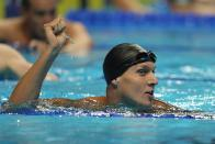 Caeleb Dressel reacts after winning the men's 100 butterfly during wave 2 of the U.S. Olympic Swim Trials on Saturday, June 19, 2021, in Omaha, Neb. (AP Photo/Jeff Roberson)