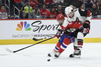 Washington Capitals defenseman Michal Kempny (6), of the Czech Republic, battles for the puck against Arizona Coyotes center Nick Schmaltz (8) during the first period of an NHL hockey game, Monday, Nov. 11, 2019, in Washington. (AP Photo/Nick Wass)