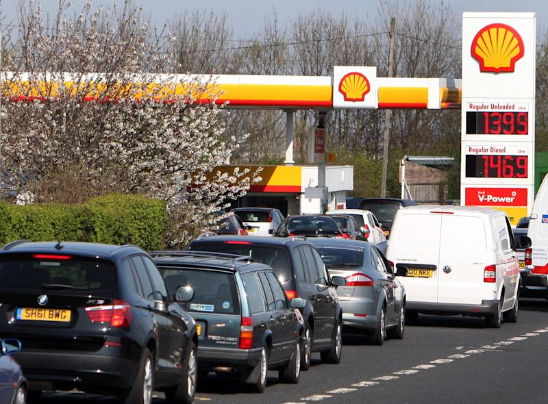 Drivers queue for petrol and diesel at a fuel station in Gateshead, England, Thursday, March 29, 2012. Police in southwest England have asked gas stations to close temporarily amid panic-buying prompted by a threatened strike by tanker drivers. The Unite union is threatening to pull its drivers from the road over a dispute over job security and working conditions. No date for the strike has yet been set, but government ministers have warned Britons that it was sensible to stock up on extra fuel. The advice appears to have prompted panic-buying in some places.  (AP Photo/Scott Heppell)