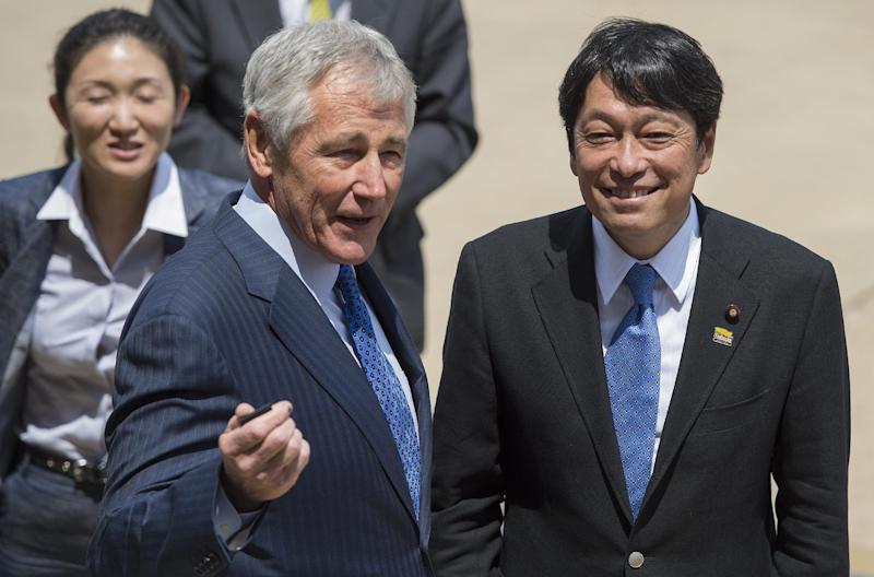 US Defense Secretary Chuck Hagel (C) welcomes Japanese Defense Minister Itsunori Onodera at the Pentagon in Washington on July 11, 2014