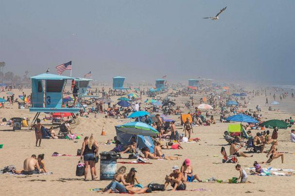 PHOTO: In this file photo taken on April 25, 2020, people enjoy the beach amid the coronavirus pandemic in Huntington Beach, California. (Apu Gomes/AFP via Getty Images)