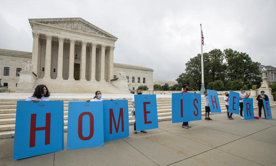 FILE - In this June 18, 2020, file photo, Deferred Action for Childhood Arrivals (DACA) students gather in front of the Supreme Court in Washington. Attorney General Merrick Garland has tossed out a Trump administration policy that barred immigration judges from temporarily shelving some deportation cases. Garland on Thursday, July 15, 2021, overruled a decision by then-Attorney General Jeff Sessions that judges couldn't put those cases on hold.(AP Photo/Manuel Balce Ceneta, File)