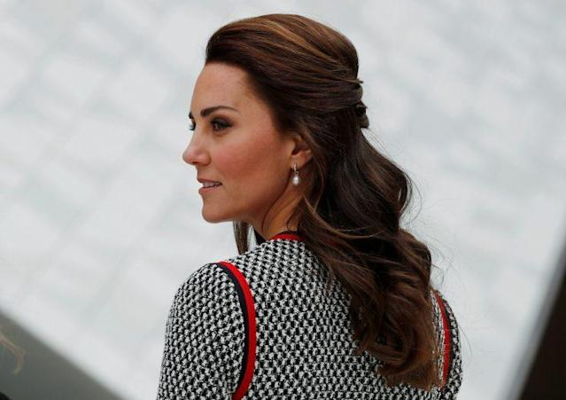 Kate styled her hair in a half up-do, showing off her favorite pearl earrings. (Photo: Reuters)