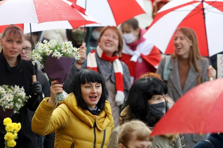 Protesters chant slogans as they take part in a women's march against Belarus' presidential election results and police violence