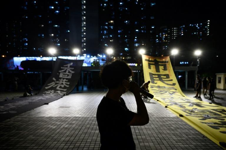 Protesters rallied and unfurled banners late into the night in the Wong Tai Sin area of Hong Kong's Kowloon district