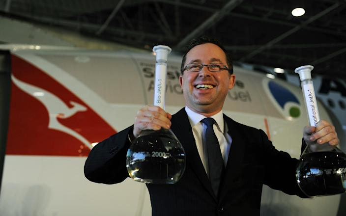 Qantas chief executive Alan Joyce poses during a media conference at Sydney Airport ahead of Australia's first flight powered by sustainable aviation fuel on April 13, 2012 - Getty