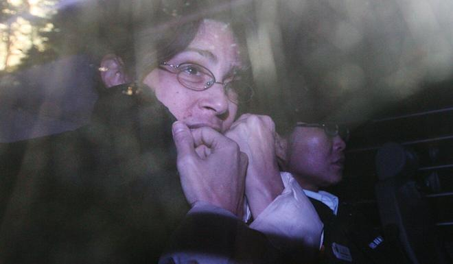 Nancy Kissel is escorted to the 2010 appeal of her conviction for murdering husband Robert Kissel with a lead ornament in their Hong Kong luxury flat. Photo: SCMP